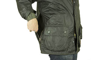 0418e571474cf The large zipped rear poachers pocket, shown here on a Beaufort, One of the  game pockets on a Barbour Border ...