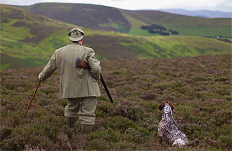 Gamekeeper and dog on his land